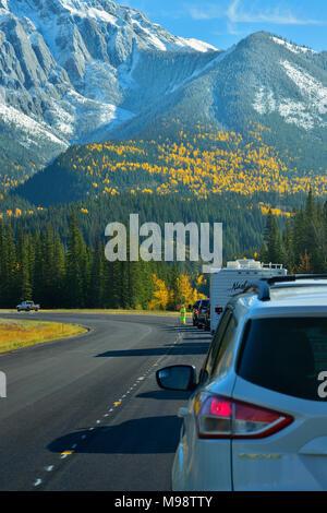 A vertical image of the highway going east of the town of Jasper with worker stopping the traffic because of repairs being done on the highway in Jasp - Stock Photo