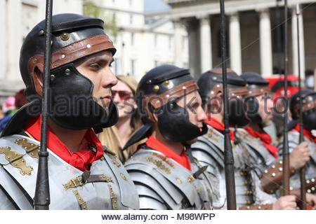 A group of participants dressed up in Trafalgar Square as Roman soldiers where the Easter performances were held at the weekend. - Stock Photo