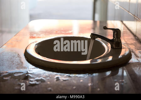 dirty old sink in the public restroom - Stock Photo