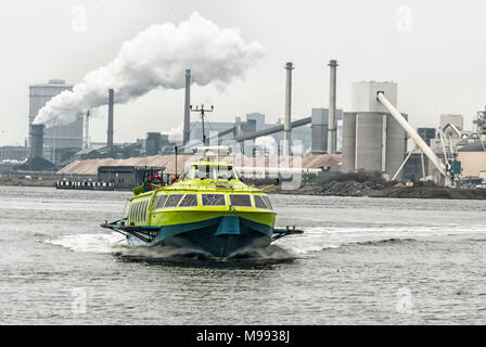 hydrofoil at full speed sailing through the North Sea Canal - Stock Photo