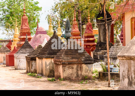 Stupa, traditional Buddhist burial gravestones at a temple in a rural area of Cambodia
