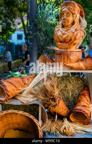 Plebeian fertility goddess Ceres of the Aventine Triad cult with symbolic horns of plenty made from wheat displayed in street in Rome in June 2017 - Stock Photo