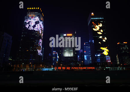 Skyscrapers in Futian district at night. - Stock Photo