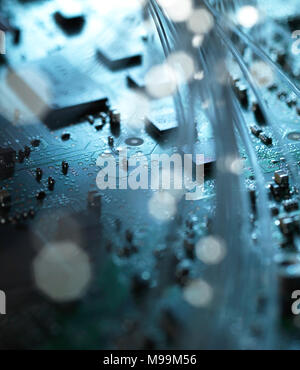 Fibre optics, hardware, circuit board in the background - Stock Photo