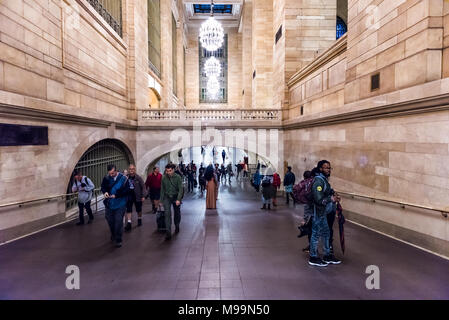 New York, USA - October 29, 2017: Grand central terminal entrance from subway in New York City with dark arched pathway corridor, many crowd crowded p - Stock Photo