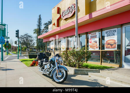 Temple City, FEB 13: Exterior view of the famous Carl's Jr with a motorbike on FEB 13, 2018 at Temple City, Los Angeles County, California - Stock Photo