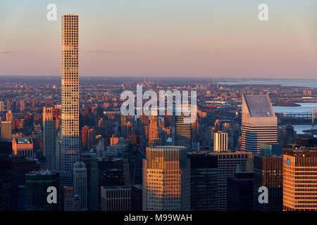 Aerial Sunset view of the skyscrapers of Midtown Manhattan and 432 Park Avenue luxury building (tallest residential building in USA, as of April 2018) - Stock Photo