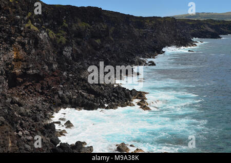Rugged volcanic cliffs and coastline in Rapa Nui island (Easter Island) - Stock Photo