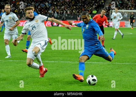 Moscow, Russia - March 23, 2018. Russian centre-back Vladimir Granat and Brazilian winger Douglas Costa during international test match Russia vs Brazil in Moscow. Credit: Alizada Studios/Alamy Live News - Stock Photo