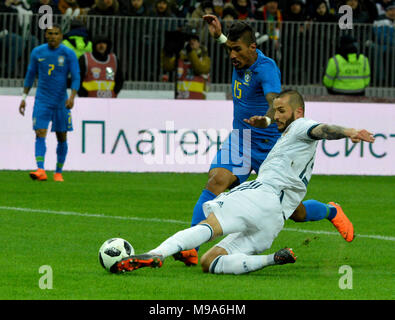 Moscow, Russia - March 23, 2018. Russian defender Fedor Kudryashov in slide tackle against Brazilian midfielder Paulinho during international test match Russia vs Brazil in Moscow. Credit: Alizada Studios/Alamy Live News - Stock Photo