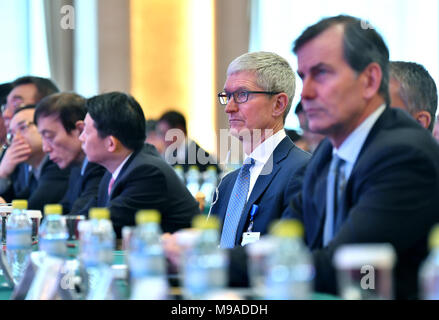 Beijing, China. 24th Mar, 2018. Apple CEO Tim Cook (2nd R) listens at the China Development Forum (CDF) Economic Summit in Beijing, capital of China, March 24, 2018. China Development Forum, hosted by the Development Research Center of the State Council, is being held from March 24 to 26. Credit: Li Xin/Xinhua/Alamy Live News - Stock Photo