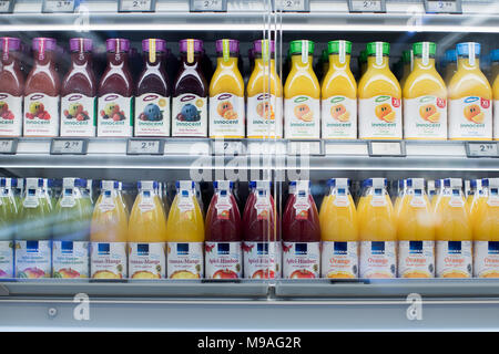 21 March 2018, Germany, Duesseldorf: A view of orange juice in the fridge of an Edeka store. Edeka entrepreneur a Heinz Zurheide inaugurated on 22 March 2018 his seventh and currently largest supermarket in the North Rhine-Westphalian capital. More and more high class supermarkets are being inaugurated in numerous cities, causing 'normal' supermarket models to be left behind. Photo: Rolf Vennenbernd/dpa - Stock Photo