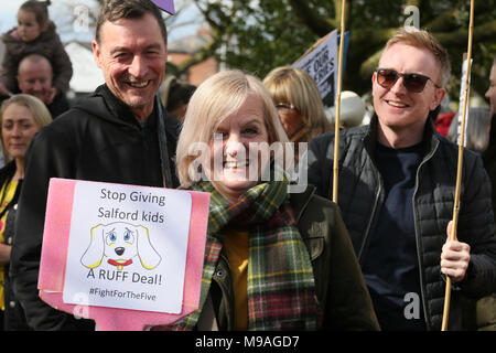Salford, UK. 24th March, 2018. A women holding a sign which reads 'Stop giving Salford Kids A Ruff Deal', Swinton, Salford, 24th March, 2018 (C)Barbara Cook/Alamy Live News - Stock Photo