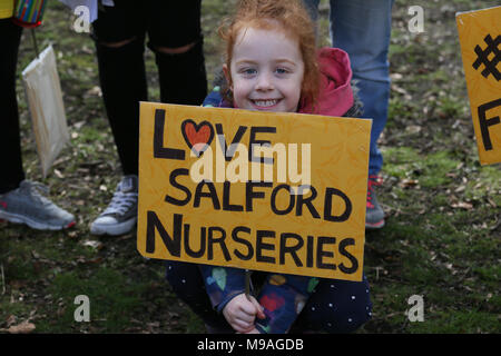 Salford, UK. 24th March, 2018. A girl with a sign which reads 'Love Salford Nurseries', Swinton, Salford, 24th March, 2018 (C)Barbara Cook/Alamy Live News - Stock Photo