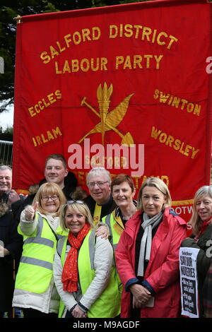 Salford, UK. 24th March, 2018. Salford District labour Party Banner propped up behind campaigners, Swinton, Salford, 24th March, 2018 (C)Barbara Cook/Alamy Live News - Stock Photo