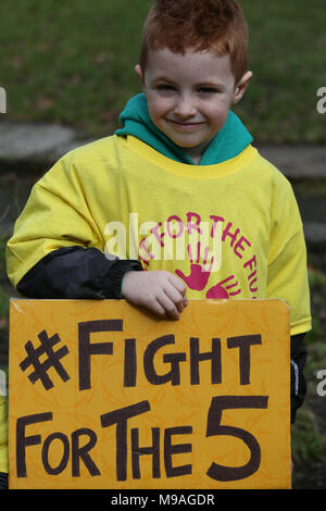 Salford, UK. 24th March, 2018. A young boy with a sign which reads 'Fight for the 5', Swinton, Salford, 24th March, 2018 (C)Barbara Cook/Alamy Live News - Stock Photo