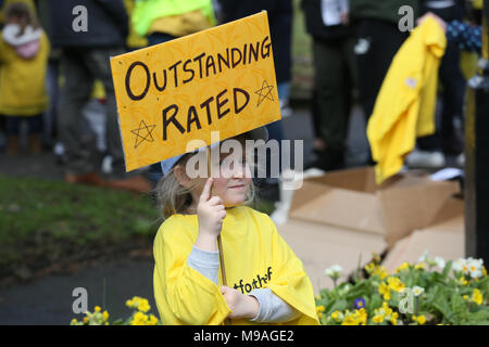 Salford, UK. 24th March, 2018. A girl holding a sign which reads 'Outstanding rated' referring to the schools threatened with closure, Swinton, Salford, 24th March, 2018 (C)Barbara Cook/Alamy Live News - Stock Photo