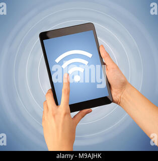Hand holding tablet with signal icon and code matrix background female fingers touching tablet with wireless connection icon stock photo voltagebd Gallery