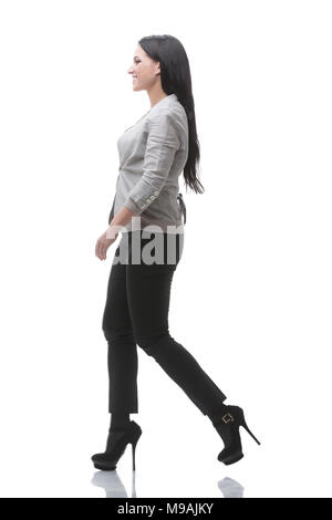 full-length. side view. modern young woman confidently goes forward - Stock Photo