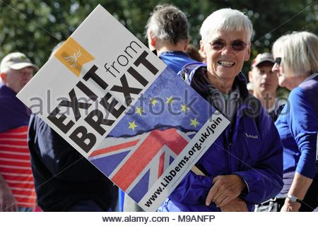A woman with an exit Brexit sign during a march against brexit organised by the Liberal Democrats in London in 2017. Credit: reallifephotos/Alamy - Stock Photo