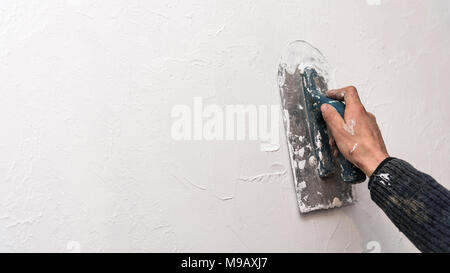 Plastering wall, work with spatula, creating relief pattern on the wall, workflow, banner with place for text - Stock Photo