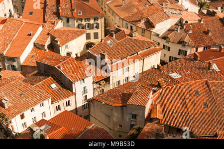 The clay tiled roofs of the old town of Foix in the Pyrenees, Ariège, southern France - Stock Photo
