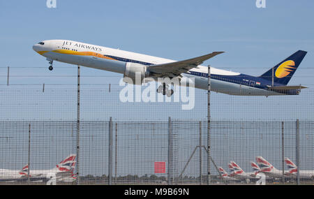 Jet Airways Boeing 777 VT-JEU departing London Heathrow Airport LHR - Stock Photo
