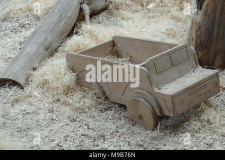 Handcrafted wooden train on an beige carpet, retro toned image - Stock Photo