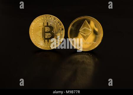 Gold coin bitcoin and Ethereum isolated on black background - Stock Photo