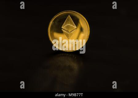 Gold coin Ethereum isolated on black background - Stock Photo
