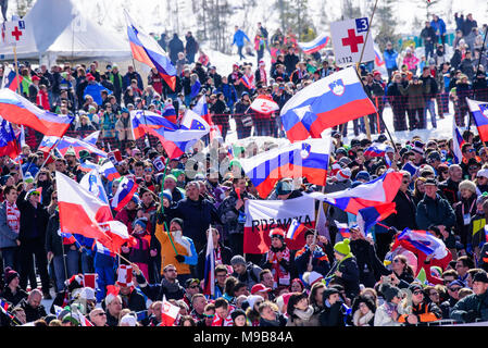 Planica, Slovenia. 24th Mar, 2018. Spectators cheering and watching competition of FIS Ski Jumping World Cup finals in Planica, Slovenia on March 24, 2017. Credit: Rok Rakun/Pacific Press/Alamy Live News - Stock Photo