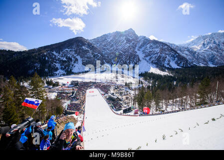 Planica, Slovenia. 24th Mar, 2018. Crowd of 20 000 spectators watching and cheering at the FIS Ski Jumping World Cup finals in Planica, Slovenia on March 24, 2017. Credit: Rok Rakun/Pacific Press/Alamy Live News - Stock Photo