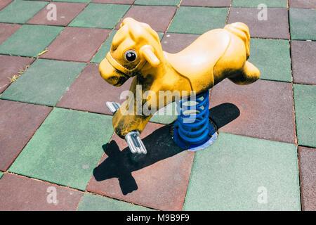 Toy horse in childrens playground, Korea - Stock Photo