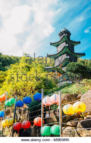 Stone tower with Buddha's Birthday lanterns in Wawoo Temple, Korea - Stock Photo