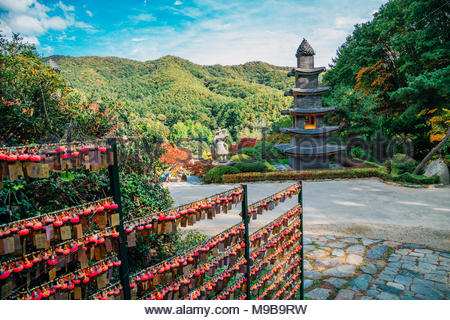 Stone tower with hanging lotus miniature in Wawoo Temple, Korea - Stock Photo