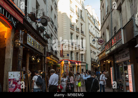 Latin Quarter of Paris, France. Narrow street of Paris among old traditional parisian houses and cafe in Paris. - Stock Photo