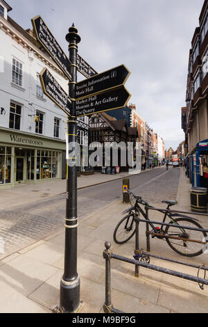 Tourist information sign and Tudor style buildings and facades on the high street in the centre of Shrewsbury an historic town in England - Stock Photo