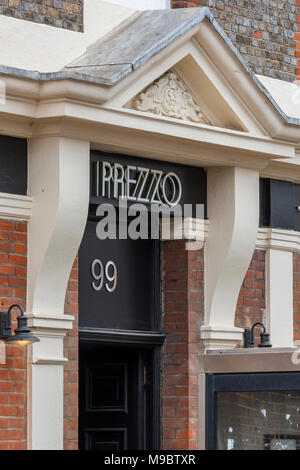 Prezzo fast foods takeaway high street restaurant front door. Branding in high street. Logo and insignia badge of restaurant chain. Food eating chain. - Stock Photo