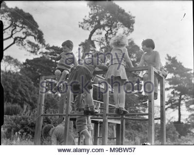 Life at the Tapley Park Children's Home (the Chaim Weizmann Home), Instow, Devon, October 1942 Children play on a climbing frame in the grounds of the Chaim Weizmann Home at Tapley Park, Instow, Devon. - Stock Photo