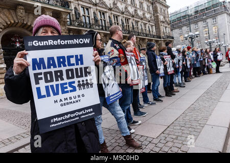 24 March 2018, Germany, Hamburg: Americans and Germans protesting with pictures of people killed during school shootings in the US in front of City Hall during the 'March for our Lives' for stricter gun control in the US. Photo: Markus Scholz/dpa - Stock Photo