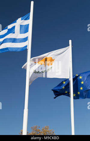 The flags of Greece, Cypus, and the European Union. - Stock Photo