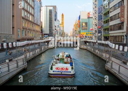 Tourists enjoying the cruise on canal, osaka, japan - Stock Photo