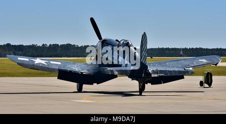 A vintage World War II-era Vought F4U Corsair flying at Moody Air Force Base in Georgia. - Stock Photo