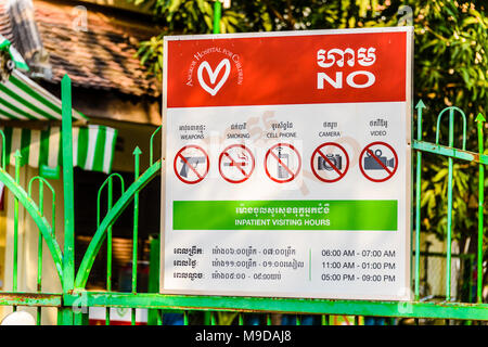 Sign at Siem Reap Children's Hospital, warning visitors of banned items and activities, Siem Reap, Cambodia - Stock Photo