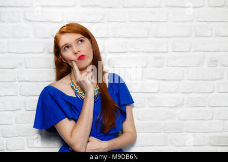 Facial Expressions Of Young Redhead Woman On Brick Wall - Stock Photo