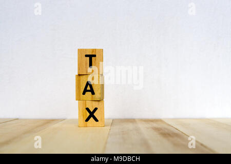 Tax on wood blocks - business and financial concept - Stock Photo