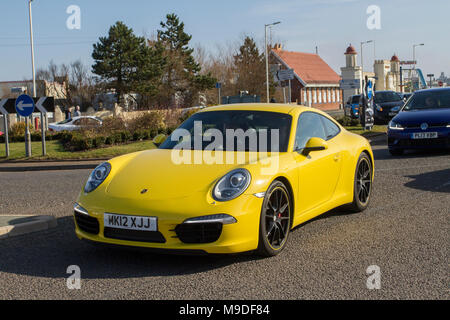 2012 yellow Porsche 911 Carrera S S-A; North-West Supercar event as hundreds of cars and tourists arrive in the coastal resort of Southport, on a warm spring day. SuperCars are bumper to bumper on the seafront esplanade as classic & vintage car enthusiasts enjoy a motoring day out. - Stock Photo