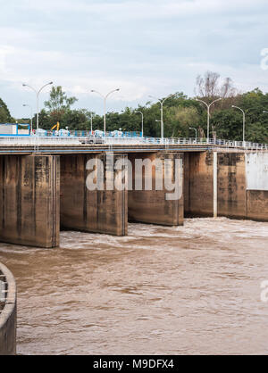 Small concrete dam is open the gate for flowing the water in the countryside of Thailand. - Stock Photo