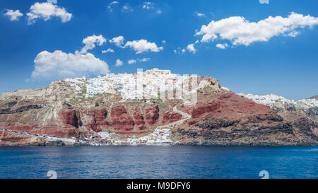 Santorini, Cyclades Islands, Greece. View from the see of Oia village and Amoudi harbour in Thira island - Stock Photo