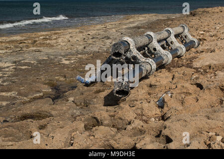 Large piece of plastic debris, environmental pollution,  covered in barnacles washed ashore on the kato paphos beach in cyprus, europe, mediterranean - Stock Photo